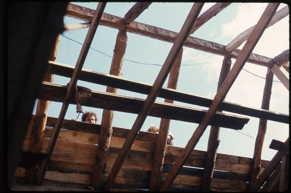 Roofing work on the barn, Montague Farm Commune: view from the interior, October 1976