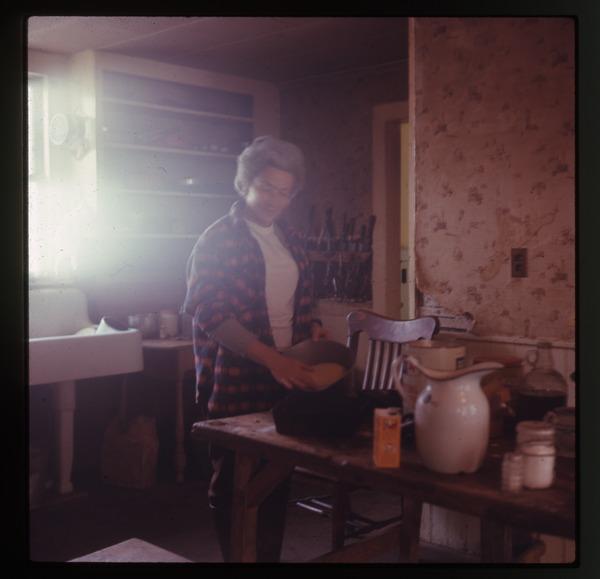 Baking bread in kitchen (Nina's mother), Montague Farm Commune, January 1971