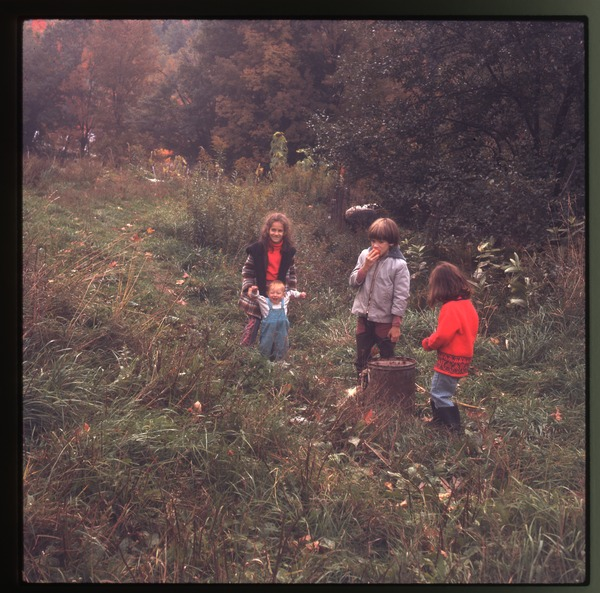 Children playing in a field, Montague Farm Commune, December 1971