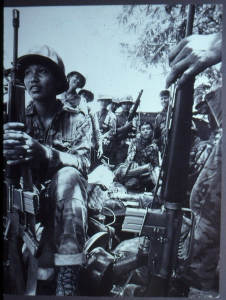 Soldiers sitting and waiting, ca. 1972