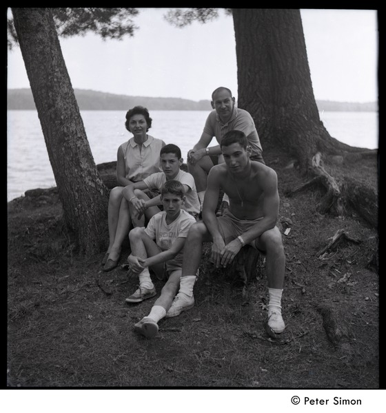 Camp Arcadia: three campers and parents seated lakeside, 1961