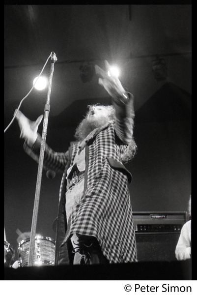 Ian Anderson (Jethro Tull) in performance, exhorting the audience, Newport Jazz Festival, July 4, 1969