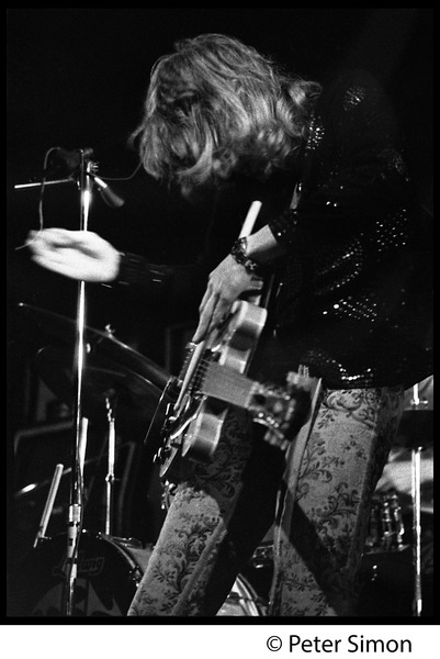 Alvin Lee (guitar, Ten Year After) in performance, Newport Jazz Festival: Lee using drumstick as a slide on his guitar: , July 4, 1969