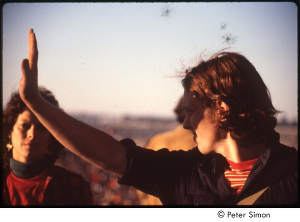 MUSE concert and rally: Sam Lovejoy, shielding his eyes from the sun at the No Nukes rally, September 23, 1979
