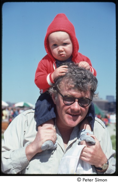 MUSE concert and rally: man with baby on his shoulders, September 23, 1979