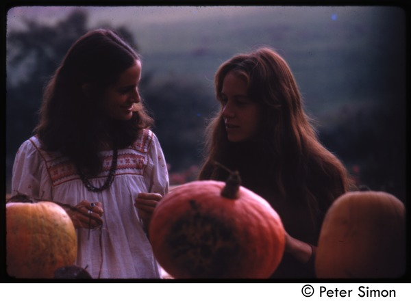June Arons and Lacey Mason with three pumpkins, Tree Frog Farm commune, ca. 1972