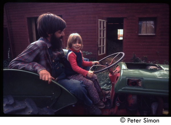 Father and child on a tractor, Tree Frog Farm commune, ca. 1972