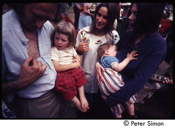 Middle-aged man with Lacey Mason, Catherine Blinder (l. to r.) and babies, Tree Frog Farm commune, May 1973