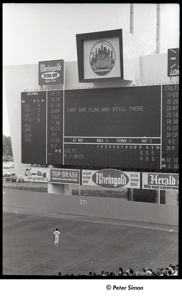 Mets at Shea Stadium: Shea Stadium scoreboard during the playing of the national anthem, Joe Christopher watches from the field, September 7, 1964