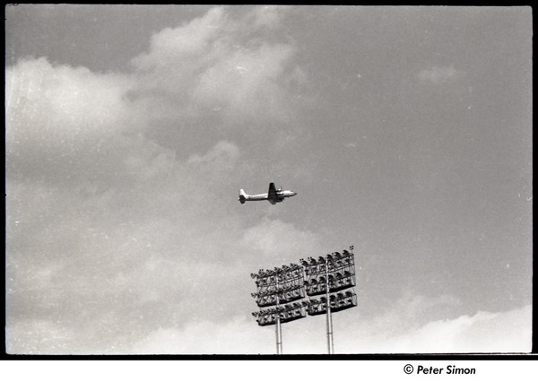 Mets at Shea Stadium: airplane above stadium lights, September 7, 1964