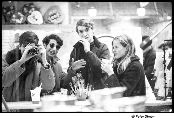 Peter Simon photographing friends in a restaurant mirror, ca. February 1967