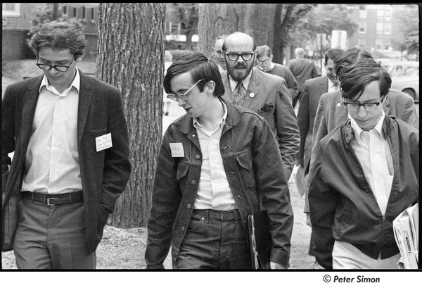 United States Student Press Association Congress: (l-r) Alex Jack, Raymond Mungo, unidentified man, and Ed Siegel walking outside, August 1967