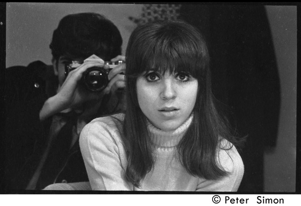 Peter Simon photographing Jennie Blackton through a mirror at the Bitter End Coffee House, January 1968