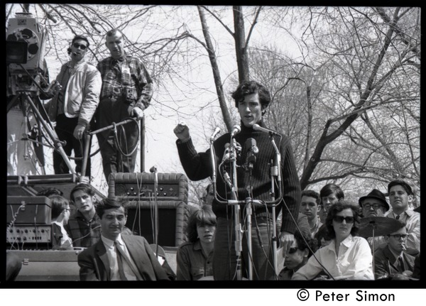 Resistance on the Boston Common: Terry Cannon (draft resister and member of the             Oakland 7) addressing the crowd, Howard Zinn seated on stage (left), April 3, 1968