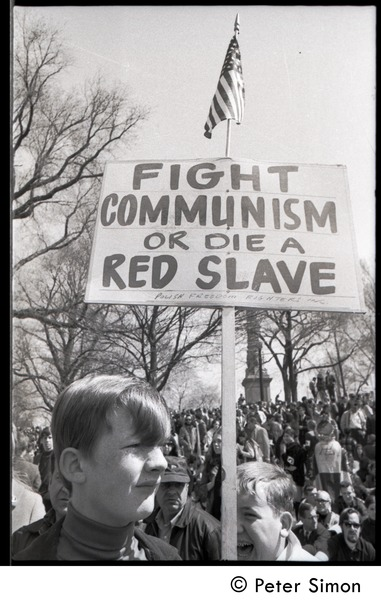 Resistance on the Boston Common: young counter-protester (Polish Freedom             Fighters Inc.) carrying sign reading 'Fight Communism or die a red slave', April 3, 1968