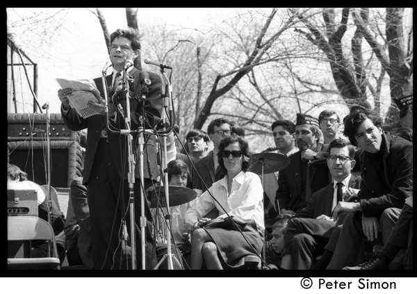 Resistance on the Boston Common: Staughton Lynd addressing the crowd with Terry             Cannon (far right) and Noam Chomsky (2d from right) seated on stage, April 3, 1968