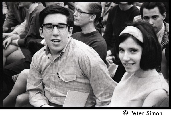 Young couple in crowd awaiting speech by presidential candidate Eugene McCarthy at Boston             University, April 10, 1968