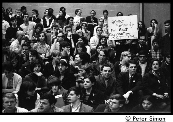 Audience awaiting speech by presidential candidate Eugene McCarthy at Boston             University: Placard held by crowd member reads 'Bobby Kennedy for best supporting actor': , April 10, 1968