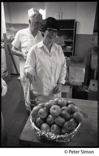Cafeteria workers with bowl of apples at Shelton Hall, Boston University, September 19, 1968