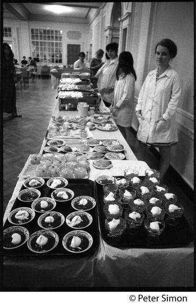 Cafeteria workers on the service line (with dessert in foreground) at Shelton Hall, Boston University, September 19, 1968