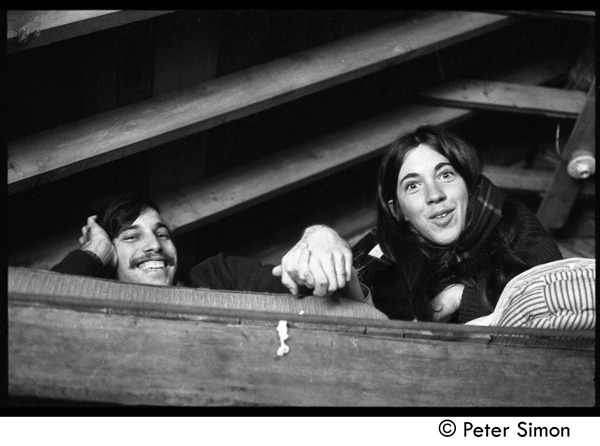 Elliot Blinder and unidentified woman lying in the rafters, Packer Corners commune, November 10, 1968
