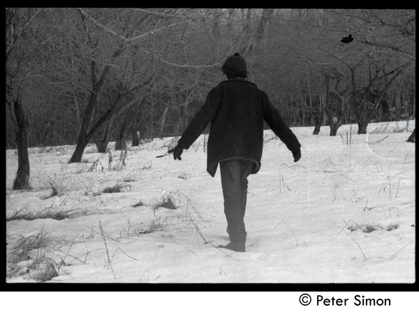 Raymond Mungo trudging through the snow, Packer Corners commune, November 23, 1968
