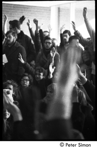 Crowd raising their hands at the demonstration: white student support for Brandeis University African American student protest, January 13, 1969