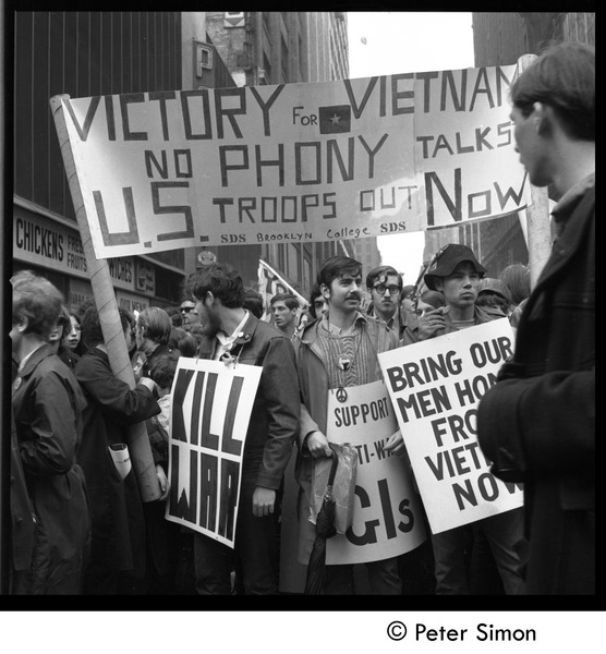 Antiwar demonstrators with banners 'Victory for Vietnam, no phony talks, US             troops out now', April 15, 1969