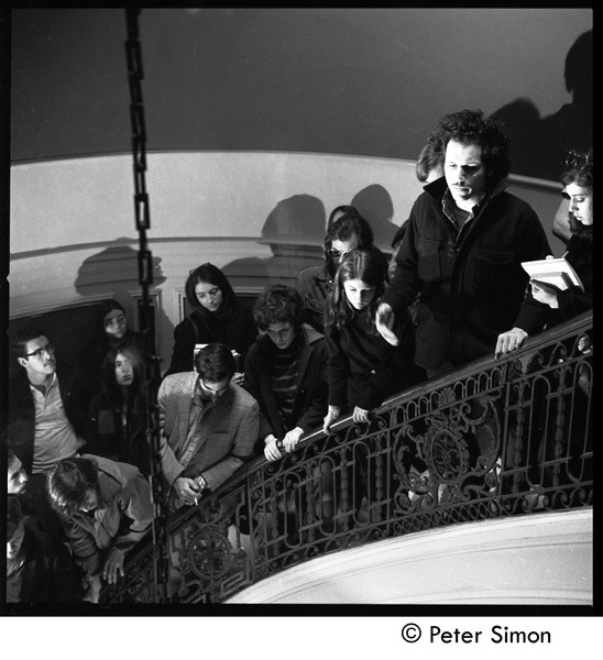 Antiwar protesters occupying University Hall, Harvard (?): student occupiers on             a stairway, April 15, 1969