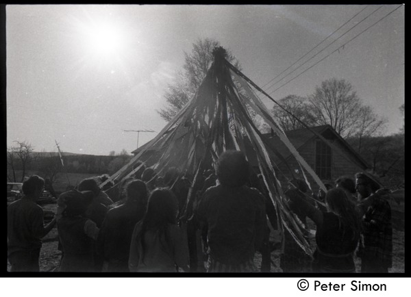 Revelers dancing around the Maypole, Packer Corners commune, ca. May 1, 1969