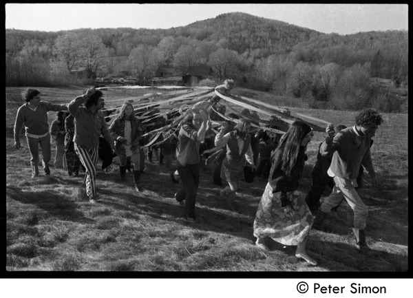 Revelers carrying the maypole into the field, Packer Corners commune: Tom Fels (far left), Jesse Kornbluth (front center), Cathy Rogers and George             Jacobs (front right): , ca. May 1, 1969