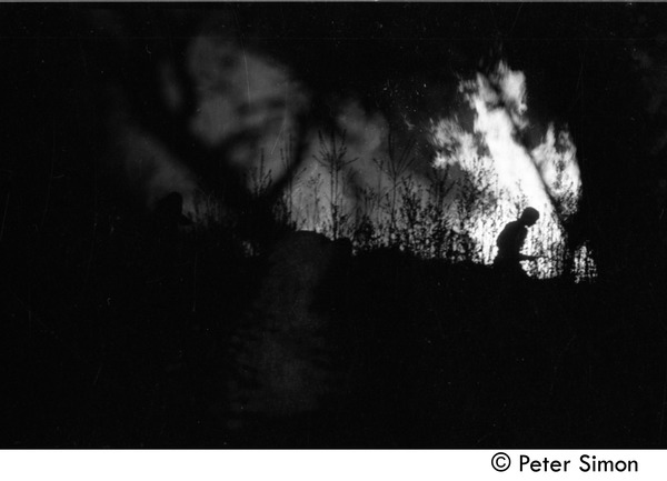 After the Maypole celebration, Packer Corners commune: silhouette and bonfire, ca. May 1, 1969