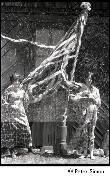 May Day at Packer Corners commune: Verandah Porche (right) and Phoebe McLean with maypole (partial double exposure), ca. May 1, 1969