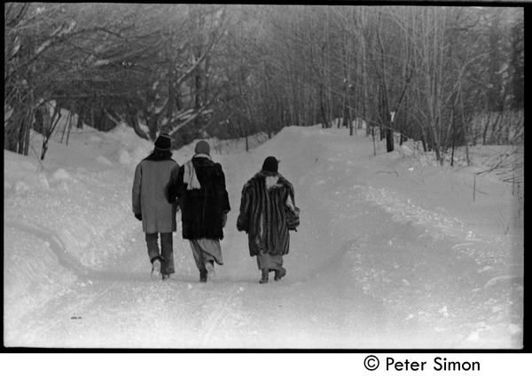 Elliot Blinder, Catherine Blinder, and Marcia Braun (l. to r.) walking down a snowy road, Tree Frog Farm commune, 1970