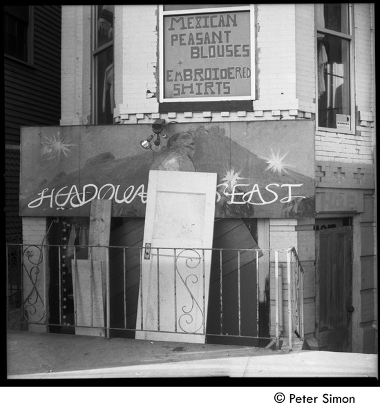 Boarded-up storefront on Harvard Square after the riot of April 15: Sign above shop reads 'Mexican peasant blouses / embroidered shirts': , April 16, 1970