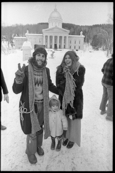 Elliot Blinder (flashing the peace sign), Catherine Blinder, and Michelle at protest against the invasion of Laos at             the Vermont State House, February 10, 1971