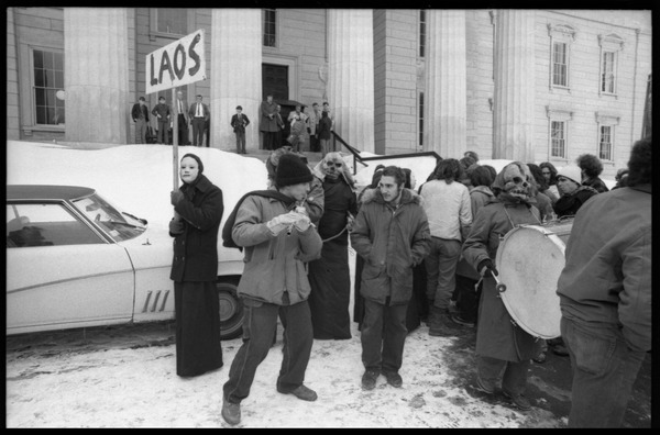 Protesters (including masked members of Bread and Puppet Theater) on the steps of the Vermont             State House during a demonstration against the invasion of Laos, February 10, 1971