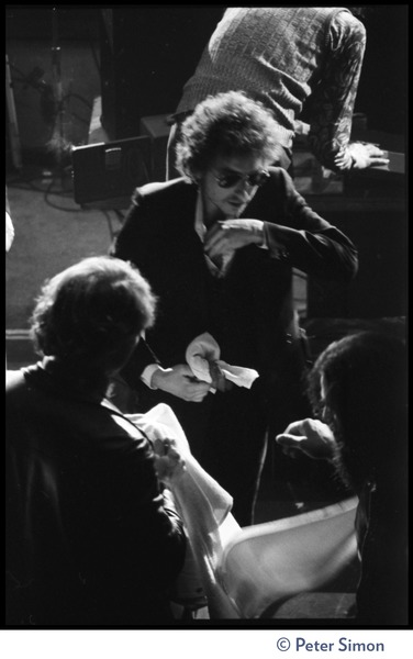 Bob Dylan walking on stage at the Boston Garden, ca. January 14, 1974
