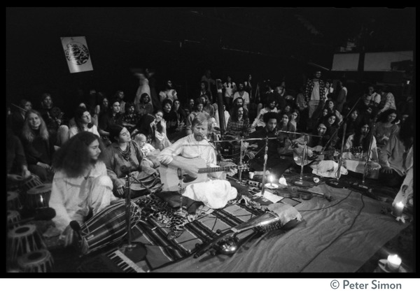 Amazing Grace (band) performing at Winterland Ballroom at Ram Dass gathering: From left: Gangadhar (perscussion), Bhagavan Das (guitar), Govind (violin), and Jai             Gopal (guitar): , ca. 1974