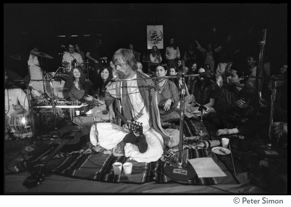 Amazing Grace (band) performing at Winterland Ballroom, at a Ram Dass gathering: Bhagavan Das (guitar) and Govind (far right): , ca. 1974
