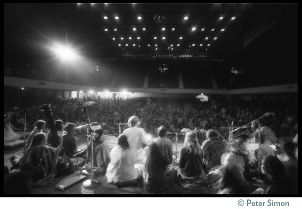 Bhagavan Das onstage in the Winterland Ballroom during the Ram Dass 'marathon,'       with Amazing Grace (view from the rear of the stage), ca. March 23, 1974