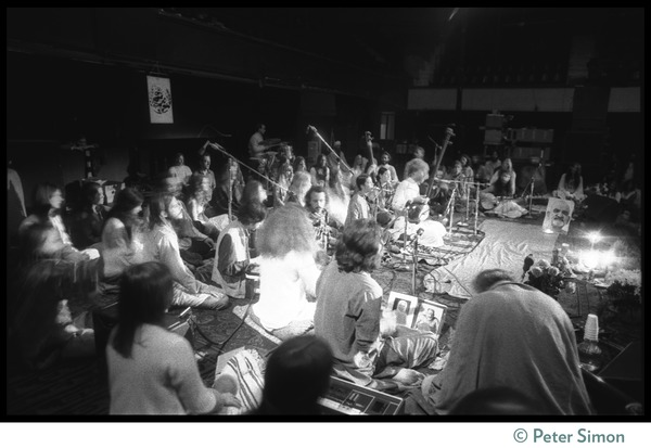 Bhagavan Das performing on stage (center) with Amazing Grace during the Ram Dass 'marathon', ca. March 23, 1974