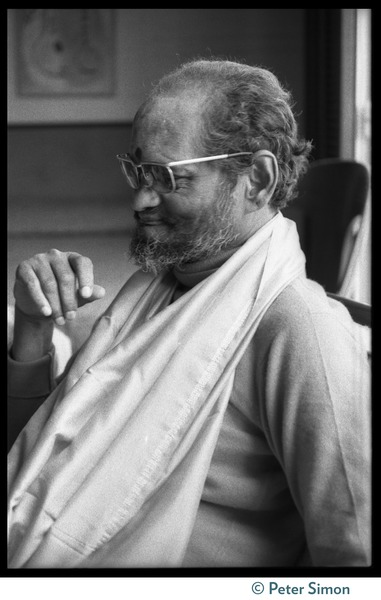 Swami Muktananda, seated in a chair: portrait in profile, ca. April 12, 1974