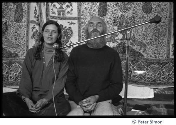 Ram Dass and woman on stage at the Rowe Center spiritual retreat, ca. May 26, 1975
