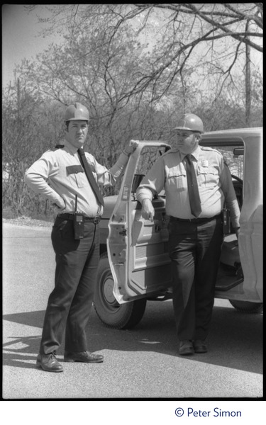 Power plant security guards in hard hats, standing by their truck as the occupation of             Seabrook Nuclear Power Plant starts up, ca. April 30, 1977