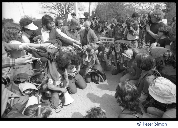 Occupiers seated in a circle, discussing plans during occupation of Seabrook Nuclear Power Plant, ca. April 30, 1977