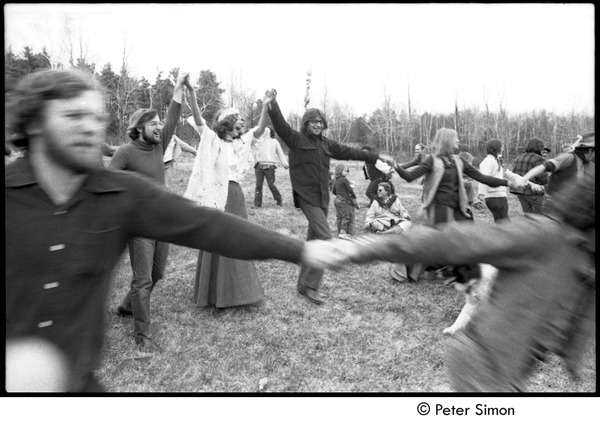 May Day at Packer Corners commune: group holding hands and dancing, May 1, 1969