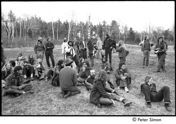 May Day at Packer Corners commune: group sitting and standing in a field, May 1, 1969