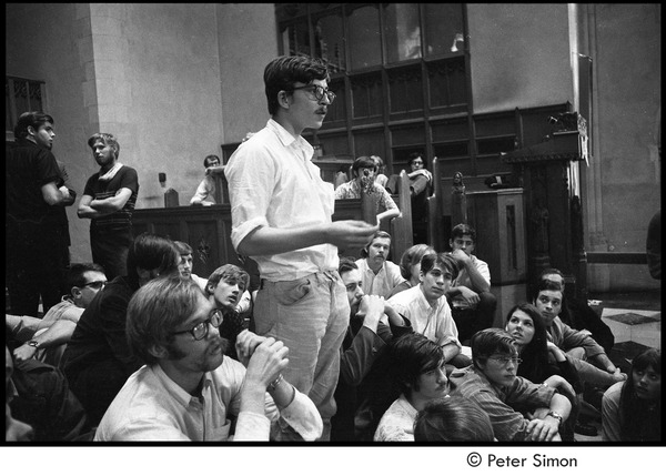 Sanctuary movement and occupation of Marsh Chapel: Raymond Kroll, deserter taking sanctuary in chapel, speaking among protestors, October 5, 1968