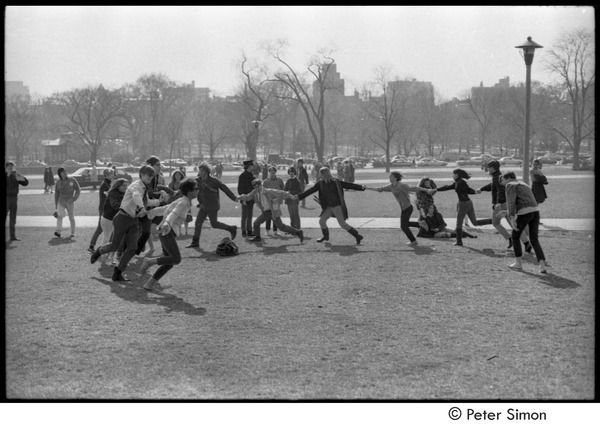 Be-in on Boston Common: participants holding hands in a circle, ca. 1967